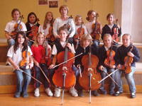 Erika Nauman with pupils from the German School